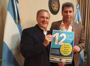 El secretario general de CAME, José Bereciartúa junto al gobernador Uñac